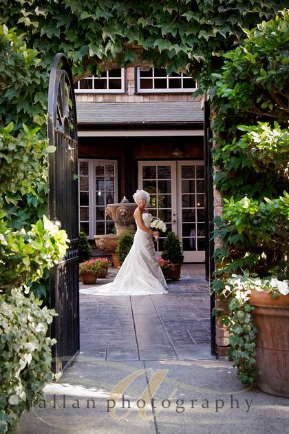 Bridal portrait through the gate